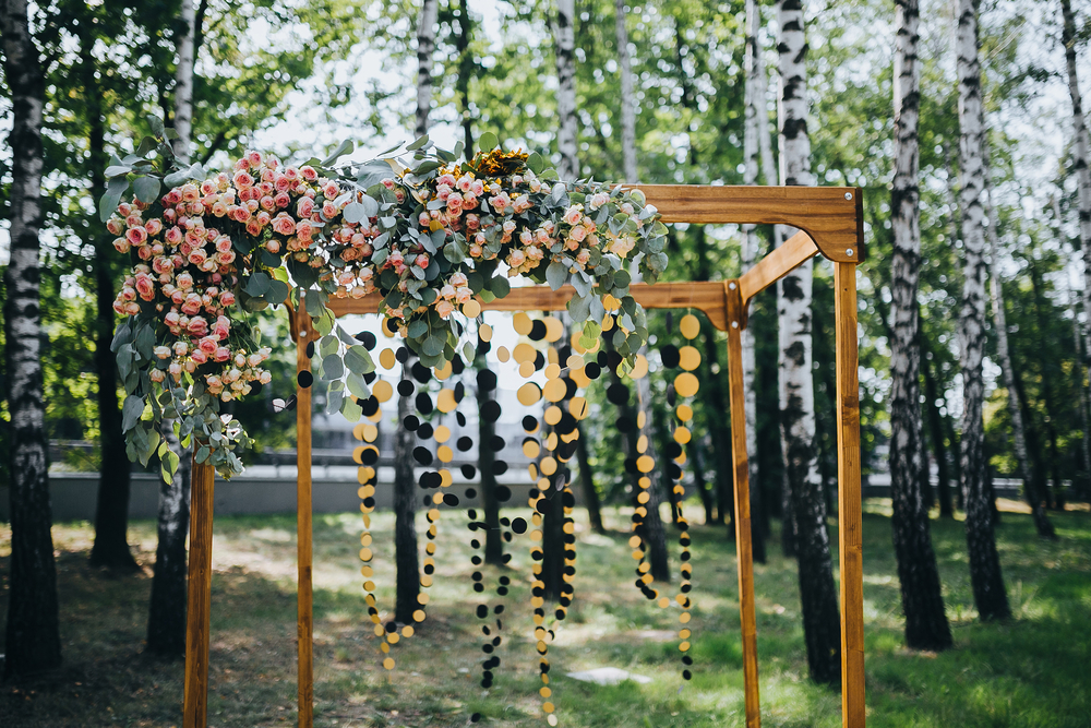 outdoor bohemian wedding - wooden frame with flowers